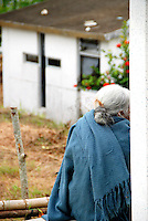 """MEXICO, Veracruz, Tantoyuca, Oct 27- Nov 4, 2009. Cecilia Gomez Hernadez de Maqueda waits for her son to return in Tantoyuca's main cemetery. """"Xantolo,"""" the Nahuatl word for """"Santos,"""" or holy, marks a week-long period during which the whole Huasteca region of northern Veracruz state prepares for """"Dia de los Muertos,"""" the Day of the Dead. For children on the nights of October 31st and adults on November 1st, there is costumed dancing in the streets, and a carnival atmosphere, while Mexican families also honor the yearly return of the souls of their relatives at home and in the graveyards, with flower-bedecked altars and the foods their loved ones preferred in life. Photographs for HOY by Jay Dunn."""