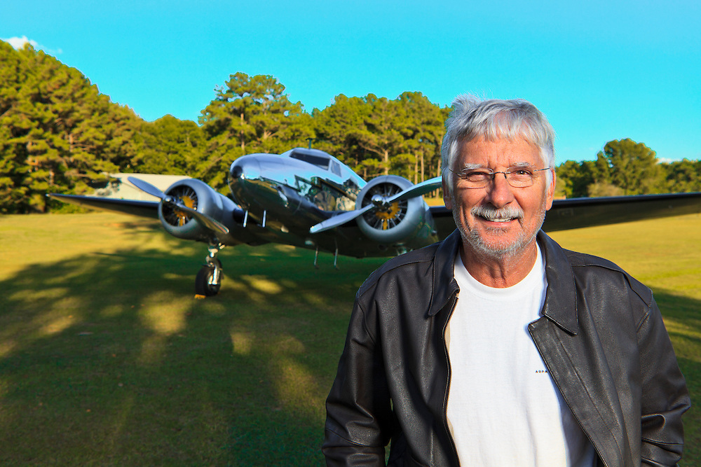 "Joe Shepherd, a retired Northwest Airlines pilot.  In the background is his completely restored and airworthy Lockheed 12-A Electra Junior, one of the few still flying.  Joe and his aircraft appeared in the motion picture ""Amelia""."