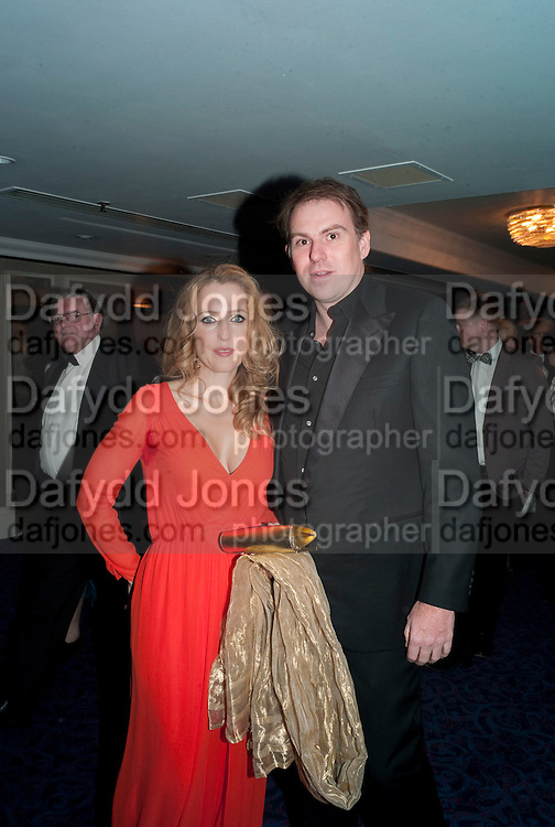 Gillian Anderson; Mark Griffiths, The Laurence Olivier Awards,The Grosvenor House Hotel, Park Lane. London.   21 March  2010