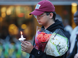Robert Schentrup holds flowers and a candle during a candlelight vigil at Memory Mall on the UCF campus in Orlando, FL, USA, in commemoration of the one-year anniversary of the mass shooting at Marjory Stoneman Douglas High School, on Thursday, February 14, 2019. Photo by Stephen M. Dowell/Orlando Sentinel/TNS/ABACAPRESS.COM