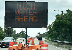 October 10, 2018 - St. Petersburg, Florida, U.S. - The warning sign heading over the bridge onto Shore Acres in St. Petersburg before high tide as Hurricane Michael passing offshore as it heads to the Florida panhandle on Wednesday. (Credit Image: © Dirk Shadd/Tampa Bay Times via ZUMA Wire)