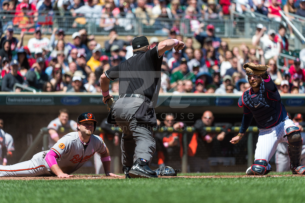 Chris Snyder #48 of the Baltimore Orioles is called out by home plate umpire Marvin Hudson after being tagged by Ryan Doumit #9 of the Minnesota Twins on May 12, 2013 at Target Field in Minneapolis, Minnesota.  The Orioles defeated the Twins 6 to 0.  Photo: Ben Krause