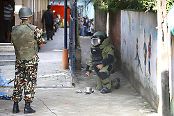 September 20, 2016 - Kathmandu, Nepal - A Nepalese Army bomb disposal personnel takes a photograph after defusing a pressure cooker bomb at Kanchanjunga School in Dallu, Kathmandu, Nepal on Tuesday, September 20, 2016. Improvised explosive devices were placed in 7 schools as 2 bombs exploded. No human casualties have been reported in the explosions. (Credit Image: © Skanda Gautam via ZUMA Wire)