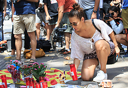 (170818) -- BARCELONA, Aug. 18, 2017 (Xinhua) -- A woman mourns victims of the terror attack on Las Ramblas area, Barcelona, Spain, on Aug. 18, 2017. At least 14 died in Thursday's double terror attacks in Spain, as Spanish people demonstrated defiance and condolences by leaders of the world poured in on Friday. (Xinhua/Xu Jinquan)  (Photo by Xinhua/Sipa USA)