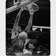 Shaquille O'Neal dunks over the Hornets in Charlotte in 1994. ©Travis Bell Photography
