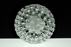 """IN PHOTO: Papiloma<br /> <br /> Internationally-renowned British artist Luke Jerram has created a coronavirus glass sculpture in tribute to the huge global scientific and medical effort to combat the pandemic.<br /> <br /> Made in glass, at 23cm in diameter, it is 1 million times larger than the actual virus. <br /> <br /> It was commissioned 5 weeks ago by a university in America to reflect its current and future research and learning in health, the environment and intelligent systems, and its focus on solving global challenges.  <br /> <br /> Luke says: """"Helping to communicate the form of the virus to the public, the artwork has been created as an alternative representation to the artificially coloured imagery received through the media. In fact, viruses have no colour as they are smaller than the wavelength of light."""" <br /> <br /> """"This artwork is a tribute to the scientists and medical teams who are working collaboratively across the world to try to slow the spread of the virus. It is vital we attempt to slow the spread of coronavirus by working together globally, so our health services can manage this pandemic."""" <br /> <br /> Made through a process of scientific glassblowing, the coronavirus model is based on the latest scientific understanding and diagrams of the virus.  <br /> <br /> Profits from this glass model are going to Médecins Sans Frontières (MSF) who will be assisting developing countries deal with the fallout of the coronavirus epidemic. <br /> <br /> This new model is just the latest in Luke's Glass Microbiology series of virus sculptures. Luke and his glassblowing team have, in the past, made other sculptures of viruses from swine flu and Ebola to smallpox and HIV.<br /> <br /> Respected in the scientific community, the glass sculptures have featured inThe Lancet,Scientific American,British Medical Journal (BMJ)and on the front cover ofNature Magazine.  <br /> <br /> TheGlass Microbiologysculptures are in museum collections around the world, inc"""