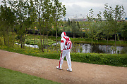 London 2012 Olympic Park in Stratford, East London. Basketball players walking around the park. The contrast between their height and those around them is stark.
