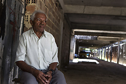 October 9, 2016 - Boa Viagem, Brazil - Mr. José awaits customers to the parking lot where he works.  José Belmiro dos Santos is 84 years old, married to Rosalia Maria da Conceição and has nine children. He is retired since 1997 and works in a parking taking care of vehicles. The parking lot is situated in an abandoned building in Boa Viagem, in Recife, Pernambuco state, Brazil.Mr. José has to live in the building and can only visit family once a month. He thinks it's dangerous, because the parking lot is located inside a slum, but need to earn cash and stay home another person can take his job.Mr. José is part of a national statistic that indicates an increase in the number of pensioners who return to work in Brazil, 5.9% in the first quarter of 2012 to 6.5% in the second quarter 2016 (data from the Brazilian Institute of geography and Statistics), due to the current economic crisis.The government of the current President Michel Temer has as one of the goals the approval of Welfare Reform, thus ensuring clearer rules for retirement and the increase in the contribution to the public coffers. The approval of new rules for retirement might take the Brazil of the crisis and increase a government approval rating scored by polemics and an impeachment questioned by the opposition. (Credit Image: © Diego Herculano/NurPhoto via ZUMA Press)