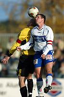 Raufoss 28092003 Raufoss Fotball - FK Haugesund 4-1. Jostein Grindhaug fra Haugesund i duell med Arild Rebne,  Raufoss.<br /> <br /> Foto: Digitalsport