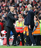 Arsenal's Arsene Wenger shakes hands with Manchester City's Pep Guadiola at the final whistle during the Premier League match at the Emirates Stadium, London. Picture date: April 2nd, 2017. Pic credit should read: David Klein/Sportimage