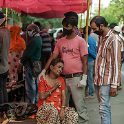 1 May 2021<br /> <br /> Indirapuram, Gazhiabad<br /> A woman struggles to breathe as she holds on to her son at the makeshift oxygen facility outside the sikh temple in Indirapuram, Gazhiabad (Uttar Pradesh)