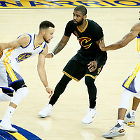 04 June 2017:Golden State Warriors guard Stephen Curry (30) drives past Cleveland Cavaliers guard Kyrie Irving (2) on screen set by Golden State Warriors forward Andre Iguodala (9) during the Golden State Warriors 132-113 victory over the Cleveland Cavaliers, in game 2 of the 2017 NBA Finals, at the Oracle Arena, Oakland, California, USA.