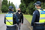 MELBOURNE, VIC - SEPTEMBER 12: A man is questioned by police during the Melbourne Freedom Walk Rally on September 12, 2020 in Melbourne, Australia. Stage 4 restrictions are in place from 6pm on Sunday 2 August for metropolitan Melbourne. This includes a curfew from 8pm to 5am every evening. During this time people are only allowed to leave their house for work, and essential health, care or safety reasons. (Photo by Dave Hewison/Speed Media)
