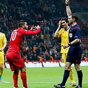 Referee's Aleksei Eskov show the yellow card to Turkey's Arda Turan during their UEFA Euro 2016 qualification Group A soccer match Turkey betwen Kazakhstan at AliSamiYen Arena in Istanbul November 16, 2014. Photo by Kurtulus YILMAZ/TURKPIX