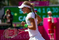 Eugenie Bouchard of Canada celebrates after winning against  Masa Zec Peskiric of Slovenia during the second day of the tennis Fed Cup match between Slovenia and Canada at Bonifika, on April 17, 2011 in Koper, Slovenia.  (Photo by Vid Ponikvar / Sportida)