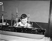 """28/05/1959<br /> 05/28/1959<br /> 28 May 1959<br /> A model of the ship """"Great Eastern"""" a 20,000 ton Iron Paddle Steamer which was to be the centrepiece of the Maritime Institute of Ireland Exhibition at the Whraf, Dun Laoghaire being moved to the exhibition hall by a special squad of C.I.E. removal men. A young boy admiring the model."""