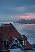 Dawn over skyline, building roof and sea Valparaiso, Chile