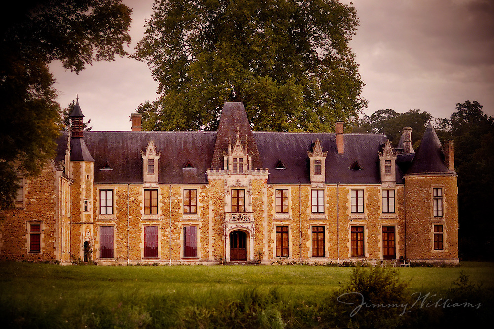The beautiful Chateau Cheronne sits amongst trees in the Loire Valley region of France, near Monfort