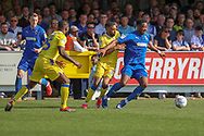 AFC Wimbledon defender Paul Kalambayi (30) battles for possession withb3\ during the EFL Sky Bet League 1 match between AFC Wimbledon and Bristol Rovers at the Cherry Red Records Stadium, Kingston, England on 19 April 2019.