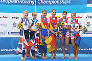 Varese,  ITALY. 2012 FISA European Championships, Lake Varese Regatta Course. ..left Silver Medalist GBR W2-  Bow Caragh MCMURTRY and Olivia CARNEGIE-BROWN Silver Medalist Women's Pair..Centre Gold Medalist ROM W2- and right Bronze Medalist. CRO W2-..11:18:23  Sunday  16/09/2012.....[Mandatory Credit Peter Spurrier:  Intersport Images]  ..2012 European Rowing Championships; .File name; Rowing, European,  2012 010896.jpg.....