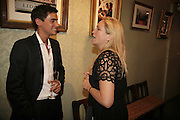 Oliver Marre and Imogen Edwards-Jones, Book launch of 'Fashion Babylon' by Imogen Edwards-Jones and Anonymous. 43 South Molton St. London. 19 July 2006. ONE TIME USE ONLY - DO NOT ARCHIVE  © Copyright Photograph by Dafydd Jones 66 Stockwell Park Rd. London SW9 0DA Tel 020 7733 0108 www.dafjones.com