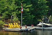 Muskoka chairds on dock<br /> Muskoka Country<br /> Ontario<br /> Canada