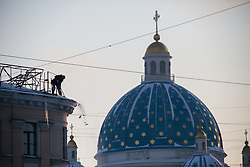 February 6, 2018 - Saint Petersburg, Russia - Workers clean the roof from snow and ice near the Trinity Cathedral in St. Petersburg, on February 6, 2018 after a two days snowfall. (Credit Image: © Valya Egorshin/NurPhoto via ZUMA Press)