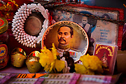 Stall with ikons and image of King Chulalongkorn Rama V set up for the Chinese New Year Celebrations in Thanon Yaowarat, the main thoroughfare which threads through Bangkok's Chinatown, Thailand.