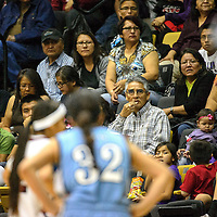 021114  Adron Gardner/Independent<br /> <br /> Former Navajo Nation President Joe Shirly enjoys some popcorn as the Window Rock Scouts battle the Many Farms Lobos in the Arizona Division III basketball tournament in Chinle Tuesday.
