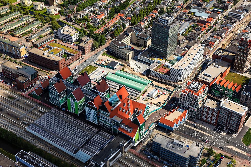 Nederland, Noord-Holland, Zaanstad, 14-06-2012; Inverdan, nieuwe stadscentrum Zaandam, masterplan Sjoerd Soeters. Station in de voorgrond. Het Zaanse huisjeshotel - Inntel Hotel - is een ontwerp Wilfried van Winden..New  center of the city of Zaandam, developed according to the master plan by architect Sjoerd Soeters. Train station in the foreground. The hotel built in a postmodern version of the style of the historic houses of Zaandam- Inntel Hotel - was designed by Wilfried van Winden...luchtfoto (toeslag), aerial photo (additional fee required).foto/photo Siebe Swart