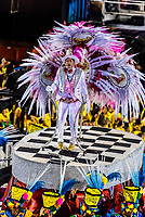 Performers on floats in the Carnaval parade of GRES Academicos de Vigario Geral samba school, Sambadrome, Rio de Janeiro, Brazil.