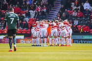 Doncaster Rovers players huddle during the EFL Sky Bet League 1 match between Doncaster Rovers and Plymouth Argyle at the Keepmoat Stadium, Doncaster, England on 13 April 2019.
