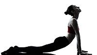 one caucasian woman sun salutation yoga surya namaskar posture position in silhouette in studio isolated on white background full length