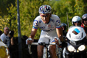 France, October 10 2010: An unidentified FDJ (FDJ) rider climbs the Côte de l'Epan during the 2010 Paris Tours cycle race.  Copyright 2010 Peter Horrell