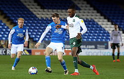 Jack Taylor of Peterborough United in action with Jerome Opoku of Plymouth Argyle - Mandatory by-line: Joe Dent/JMP - 24/11/2020 - FOOTBALL - Weston Homes Stadium - Peterborough, England - Peterborough United v Plymouth Argyle - Sky Bet League One