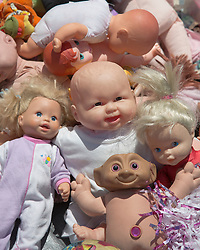 collection of dolls found in a flea market