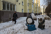 Residents walk past a set of broken panda statues in the Erdaojiang district in Tonghua, Jilin province, China, on Wednesday, Jan. 6, 2016. The citys once-vaunted state-run steel mills have slipped inexorably into decline, weighed down by slumping global markets, a changing economy, and the burden of costs and responsibilities to the people of the town they fostered. Previous attempts to privatise the enterprise have met with stiff resistance, one such attempt resulted the mob lynching and death of a private businessman who wanted to invest and streamline the operation.