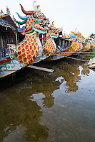 The central town of Hue is well known for its dragon boat trips along the Huong Perfume River visitors travel on these boats to visit the Vietnamese royal mausoleums.  Spectacular dragons are carved into the boat's floor and railings.  On the voyage, visitors travel along the Huong River, from Truong Tien to Bach Ho bridges. The boat cruises gently past several scenic areas of Hue, including temples, pagodas and a couple of richly decorated royal tombs.