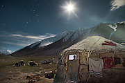 The yurt of a newly married couple lit by full moon, on the night before a trip down to the lower valley..A few years ago, envoys from the government in faraway Kyrgyzstan have offered help to the Afghan Kyrgyz community, proposing them to relocate in a valley in Kyrgyzstan? For most, it remains a difficult decision, logistically and psychologically, to abandon their homeland...Young couple - Nemat Ullah and Woolook Bu's yurt..