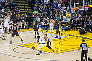 Golden State Warriors guard Stephen Curry (30) guards Dallas Mavericks guard Wesley Matthews (23) at Oracle Arena in Oakland, California, on February 8, 2018. (Stan Olszewski/Special to S.F. Examiner)