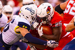 NORMAL, IL - September 21: Noe Becerra  closes in on James Robinson during a college football game between the ISU (Illinois State University) Redbirds and the Northern Arizona University (NAU) Lumberjacks on September 21 2019 at Hancock Stadium in Normal, IL. (Photo by Alan Look)