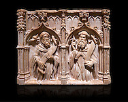 Gothic alabaster relief sculpture of two profits by Pere Oller, circa 1415, from the convent del Carme, Girona, Spain..  National Museum of Catalan Art, Barcelona, Spain, inv no: MNAC 214163. Against a black background. .<br /> <br /> If you prefer you can also buy from our ALAMY PHOTO LIBRARY  Collection visit : https://www.alamy.com/portfolio/paul-williams-funkystock/gothic-art-antiquities.html  Type -     MANAC    - into the LOWER SEARCH WITHIN GALLERY box. Refine search by adding background colour, place, museum etc<br /> <br /> Visit our MEDIEVAL GOTHIC ART PHOTO COLLECTIONS for more   photos  to download or buy as prints https://funkystock.photoshelter.com/gallery-collection/Medieval-Gothic-Art-Antiquities-Historic-Sites-Pictures-Images-of/C0000gZ8POl_DCqE