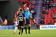 Portsmouth FC midfielder Ben Thompson (32) receives yellow card during the EFL Sky Bet League 1 match between Doncaster Rovers and Portsmouth at the Keepmoat Stadium, Doncaster, England on 25 August 2018.Photo by Ian Lyall.