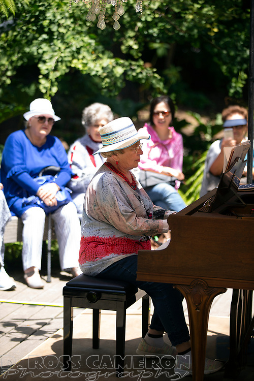 An unidentified woman who conducted her program in Russian plays a piece at the fifth annual Flower Piano exhibition at the San Francisco Botanical Garden in Golden Gate Park, Friday, July 19, 2019 in San Francisco. The exhibition continues through Monday. (Photo by D. Ross Cameron)