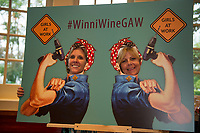 """Liz Shelley and Cathy Marder both volunteers for the """"Girls At Work"""" organization pose for a photo during the Winnipesaukee Wine Festival at Church Landing Thursday evening.  (Karen Bobotas/for the Laconia Daily Sun)"""