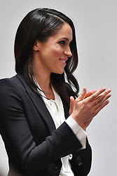 Meghan Markle applauds veteran soldier Daniel Claricoates after she presented him with the Celebrating Excellence Award as she attends the annual Endeavour Fund Awards at Goldsmiths' Hall in London, to celebrate the achievements of wounded, injured and sick servicemen and women who have taken part in sporting and adventure challenges over the last year.