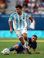 24/08/04 - ATHENS - GREECE -  - OLYMPIC FOOTBALL - SEMIFINALS - MENS  -  <br />ITALY VS. ARGENTINA ().<br />At Karaiskaki Stadium in Faliro / Athens<br />Argentine N*5 JAVIER MASCHERANO and Italy N*8 PALOMBO ANGELO.<br />© Gabriel Piko / Argenpress.com / Piko-Press