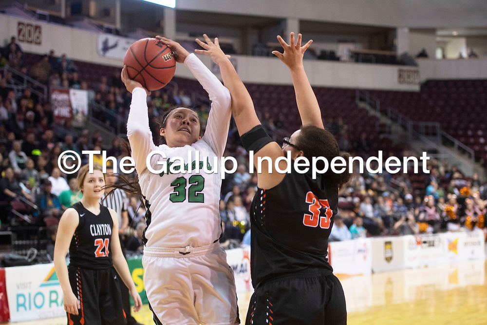 Newcomb Skyhawk Zoey Natonabah (32) drives to the basket during their 2A girls NMAA State Basketball quarterfinal playoff game against Clayton Yellowjackets at the Santa Ana Star Center in Rio Rancho Tuesday. The Yellowjackets beat the Skyhawks 63-51 to advance to the semifinal round.