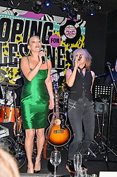KATE MOSS sings withCHRISSIE HYNDE at Hoping's Greatest Hits - the 10th Anniversary of The Hoping Foundation's charity benefit held at Ronnie Scott's, 47 Frith Street, Soho, London on 16th June 2016.