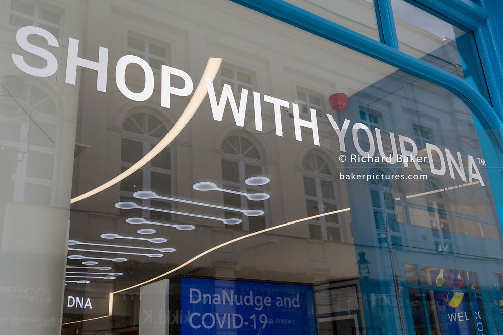 "An exterior of DnaNudge's flagship store window in Covent Garden, seen during the UK's Coronavirus pandemic lockdown period, on 26th May 2020, in London, England. DnaNudge is the world's first service to use one's own DNA and lifestyle factor to 'nudge' towards healthier choices. Following a quick and simple instore DNA test, consumers can start using a DnaBand to scan product barcodes and discover whether a food product is ""red"" or ""green"" for you. If the product is indicated as ""green"", it is a good choice but if it's red, the App will display a range of personalised recommended alternatives generated by science-led analytics."